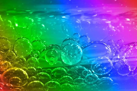 Colorful bubbles in clear water  photo