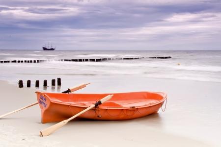lifeboat: Stormy beach  Lifeguard boat on Polish coast   Stock Photo