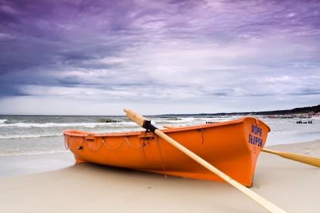 Stormy beach  Lifeguard boat on Polish coast   Stock Photo