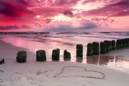 Valentine s day on the beach  Beautiful sunset with symbol of love   Stock Photo