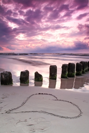 Calmness  Beautiful sunset with symbol of love  Baltic sea, Poland  photo