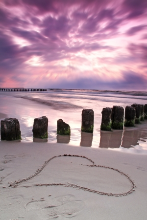 valentine s day beach: Valentine s day on the beach  Beautiful sunset with symbol of love   Stock Photo
