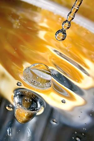 Drops of orange water  Orange stream  photo