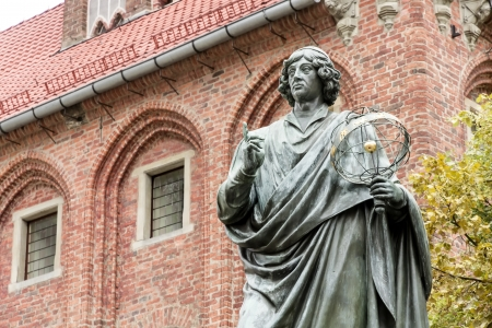 copernicus: Monument of Copernicus against Town Hall in Torun  Home town of Copernicus