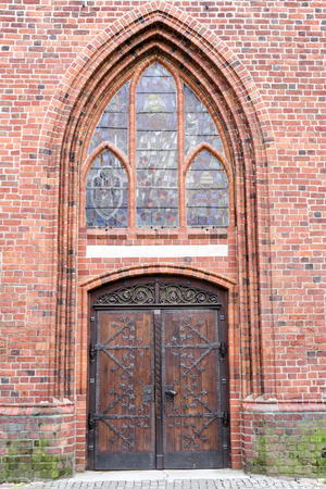 Old stylish door in Polish cathedrak in Koszalin  Gothic style  photo
