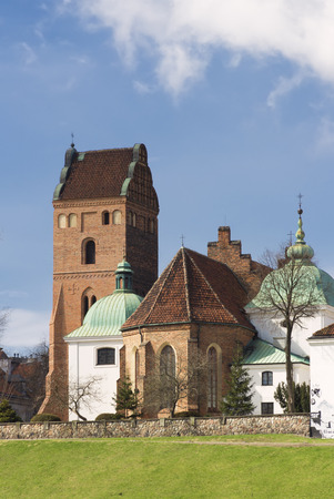sights: Sights of poland - Warsaw old town with Gothic church. Stock Photo
