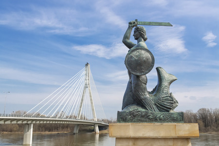 Capital of Poland - Warsaw. Symbol of Warsaw - Mermaid near suspension bridge.