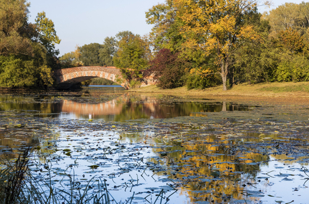 Autumn landscape. Bridge in Luxury park in Warsaw Wilanow. Capital of Poland.