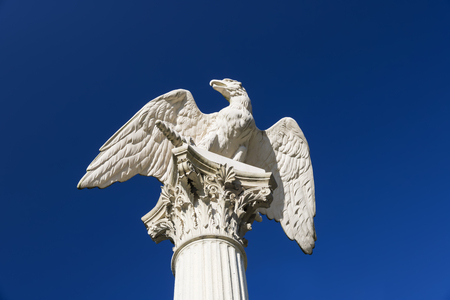 Symbol in arts - antique imperial eagle. Marble.