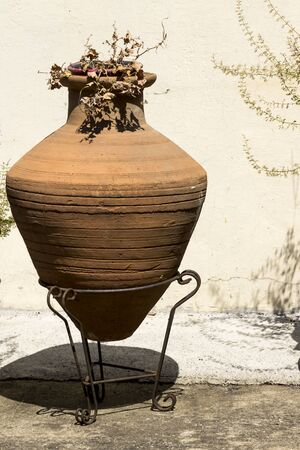 Old brown amphora in mediterranean style. Greece.