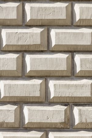 Stone wall as a background. White texture.