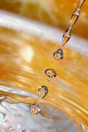 Splashed water drops. Fresh Orange Water. Natural background.