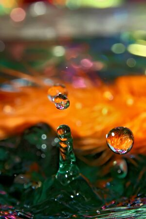 Drop on a feathers, mixed light and colors.