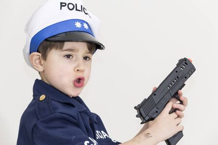Boy age 6 boy pretending to be a police officer Banque d'images