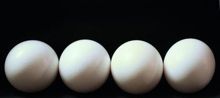 White Eggs on a Black Background