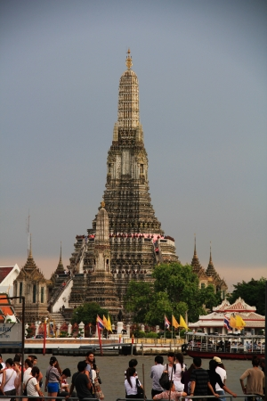 thailand s landmarks: Wat Arun is among the best known of Thailand s landmarks and the first light of the morning reflects off the surface of the temple with pearly iridescence  Editorial