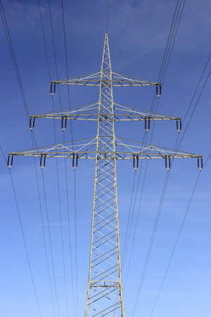 Electricity pylon in the blue sky. Energy transition environment. Symbol for electricity and energy transition.