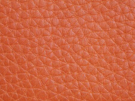 Genuine orange cattle leather texture background. Macro photo Stock fotó