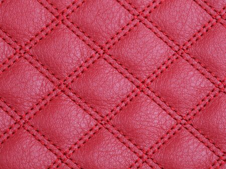 Genuine square stitched red cattle leather texture background. Macro photo Stock fotó