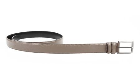 Women's beige black leather belt with a nickel buckle. Without shadows. Isolated on white background