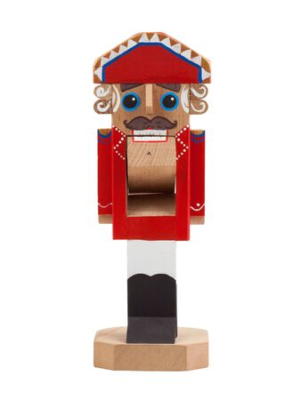 Nutcracker. Wooden Christmas toy isolated on white background. Front view