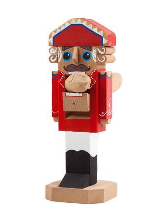 Nutcracker with cracked nut in mouth. Wooden Christmas toy isolated on white background