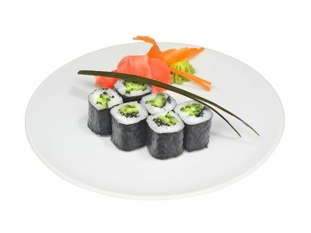 Sushi rolls with cucumber, seeds and nori with pickled ginger and wasabi on white round plate. Close-up of delicious japanese food with sushi rolls isolated on white background