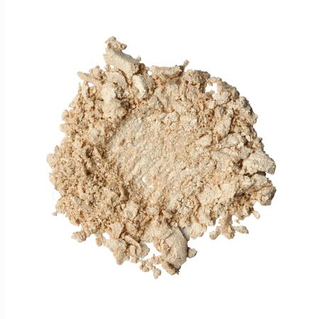 Dry crushed beige eye shadows as sample of cosmetic product isolated on white background