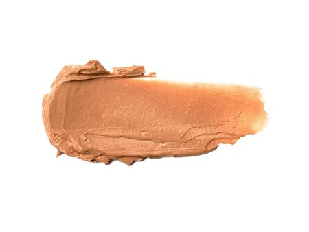 Creamy foundation smeared on white background. Isolated. Beauty and fashion conception Stock Photo
