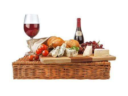 Rustic still life with cheese, bread, grapes, tomatoes, parsley and 
