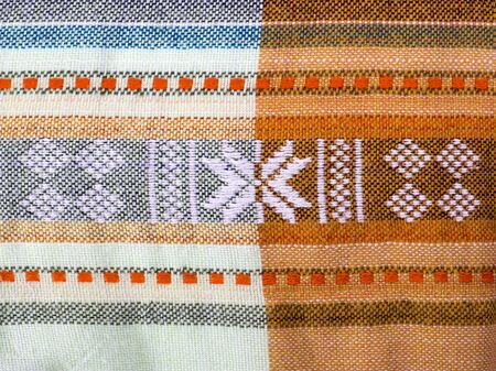 Textile texture in orange, blue and white cell. Vietnam fabric 