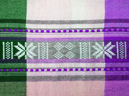 Textile texture in violet, green and white cell. Vietnam fabric 