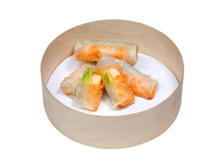 Close up of streamed fresh rice flour rolls with shrimps and avocado. Delicious japanese food isolated on white background