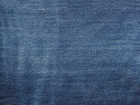 Texture of blue jeans background. Macro photo