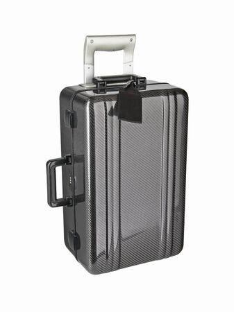 New modern black plastic travel suitcase or luggage bag isolated on white background. Without shadows