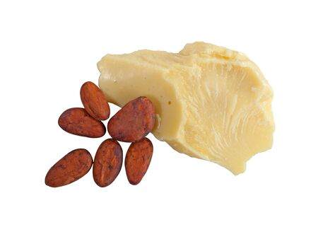 Piece of natural cocoa butter with cocoa beans isolated on white background. Macro photo