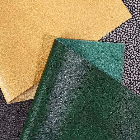 Different colors natural leather textures samples. Close-up shot
