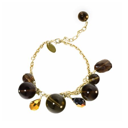 Women`s wrist bracelet of golden chain, gem stones and beads on white background. Top view