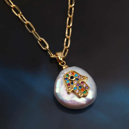 Fatima hand or Hand of God baroque pearl pendant with gold chain on black blue gradient background