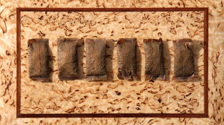 Pouches of smokeless tobacco on rough beige brown background. Top view Foto de archivo