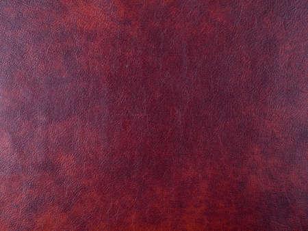 Genuine dark red leather texture background. Macro photo