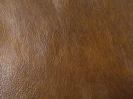 Genuine dark brown cattle leather texture background. Macro photo