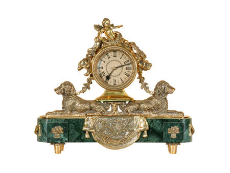 Old antique ornate clock isolated on white background