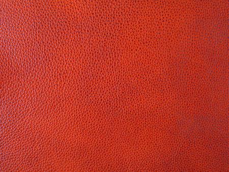 Genuine bright red cattle leather texture background. Macro photo Standard-Bild