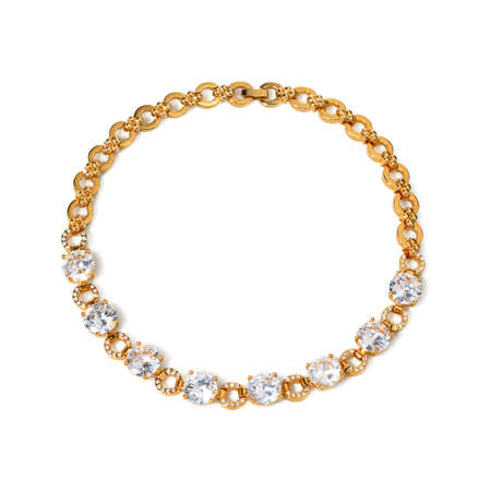 Women`s golden necklace with gemstones on white background. Top view