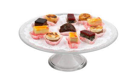 Assortment of pieces of cake with frosting on glass plate