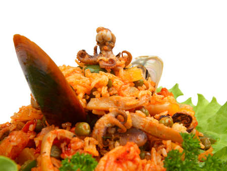 Rice with seafood and vegetables on white background. Close-up photo Stock Photo
