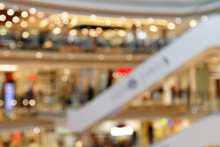 Christmas Shopping: Multilevel Christmas atmosphere. Shopping center blurred background