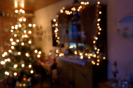 Bokeh Background - Atmospherically illuminated Family Room in Christmas Time Stock Photo
