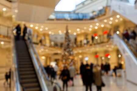 Shops, Elevators and Customers in Multistory Shopping Center in Christmas Time Bokeh Background